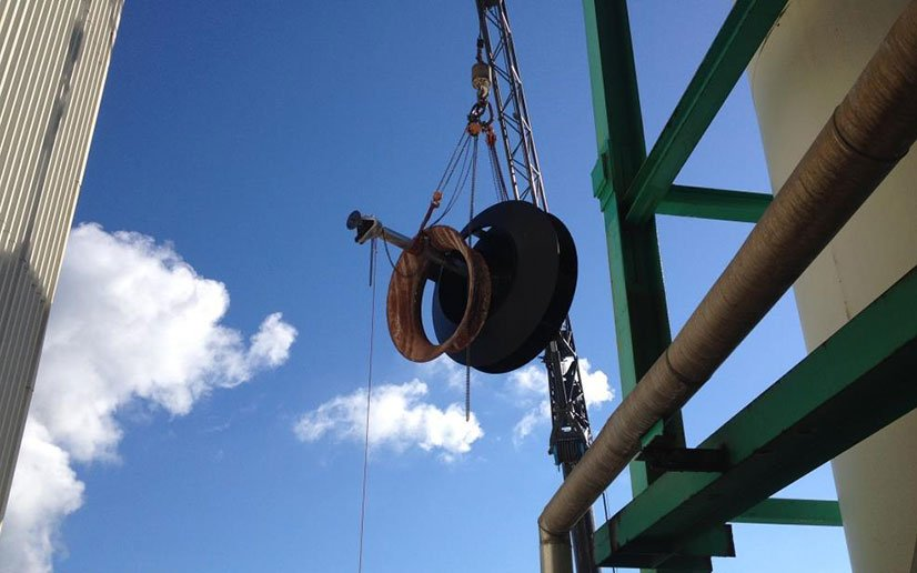 Bolier fan being installed in an industrial plant